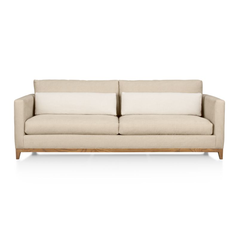 Exposed wood base takes a sturdy stance to support a deep-seated sofa that stretches long and slim. Slender track arms flank plush cushions with accent pillows that stretch out horizontally to relax the back.<br /><br />After you place your order, we will send a fabric swatch via next day air for your final approval. We will contact you to verify both your receipt and approval of the leather swatch before finalizing your order.<br /><br /><NEWTAG/><ul><li>Eco-friendly construction</li><li>Certified sustainable kiln-dried hardwood frame</li><li>Seat cushions has inner spring coil system surrounded by polyfoam with 50% recycled fiber/50%feather-down blend encased in downproof ticking</li><li>Made in North Carolina, USA</li></ul>Seat and back cushions are down blend<br /><li>Back cushions and accent pillows are 50% recycled fiber/50%feather-down blend encased in downproof ticking</li><li>Eight-way, hand-tied suspension</li><li>Solid oak legs and base with weathered grey finish</li><li>Benchmade</li><li>Made in North Carolina, USA</li></ul>