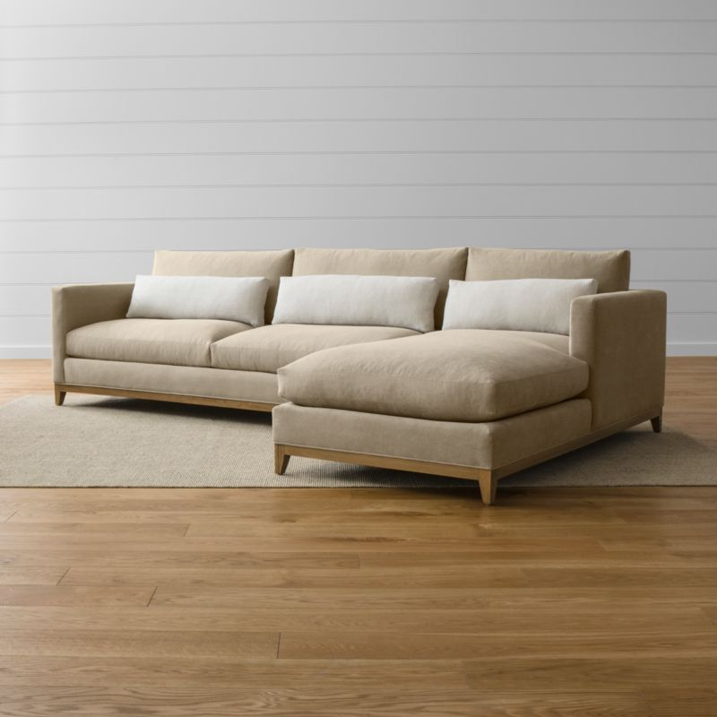 Our Taraval sectional sofa options relax all conventions about living room seating. Casual, yet elegant, the left arm sofa and right arm chaise—and their many sectional companion pieces—are upholstered in all-natural cotton. Each piece is accented with stonewashed 100% linen kidney cushions lofted with down to hug your lower back in comfort. <NEWTAG/><ul><li>Frames are benchmade in the USA with eco-friendly, certified sustainable hardwood that's kiln-dried to prevent warping</li><li>Solid oak legs and base in a weathered grey finish</li><li>Eight-way, hand-tied spring suspension system</li><li>Soy-based polyfoam seat cushions with innerspring coil system, wrapped in polyfiber and feather-down blend and encased in downproof ticking</li><li>Polyfiber and feather-down blend back cushions and kidney pillows encased in downproof ticking</li><li>Includes 3 kidney pillows</li><li>Material origin: see swatch</li><li>Made in North Carolina, USA</li></ul>