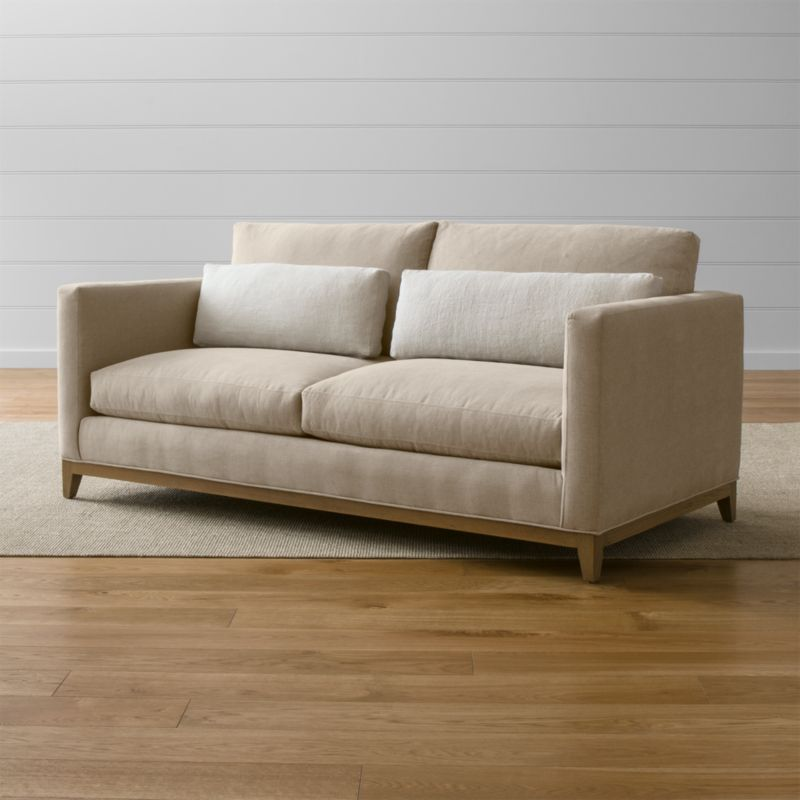 Our Taraval apartment sofa relaxes all conventions about what a living room sofa can be. Casual, yet elegant, it's upholstered in all-natural cotton with stonewashed 100% linen kidney cushions lofted with down to hug your lower back in comfort. <NEWTAG/><ul><li>Frame is benchmade in the USA with eco-friendly, certified sustainable hardwood that's kiln-dried to prevent warping</li><li>Solid oak legs and base in a weathered grey finish</li><li>Eight-way, hand-tied spring suspension system</li><li>Soy-based polyfoam seat cushions with innerspring coil system, wrapped in polyfiber and feather-down blend and encased in downproof ticking</li><li>Polyfiber and feather-down blend back cushions and kidney pillows encased in downproof ticking</li><li>Includes 2 kidney pillows</li><li>Material origin: see swatch</li><li>Made in North Carolina, USA</li></ul>
