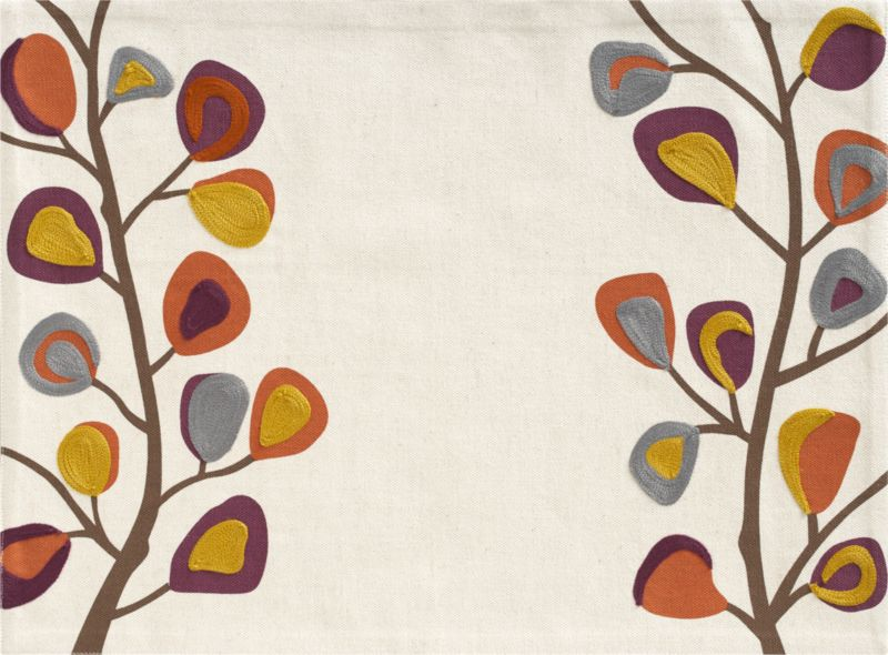 Branches of graphic blooms in mustard, cayenne, rust and grey climb the edges of a slubby linen-y cotton ground, embroidered in silky acrylic with aari embroidery, a continuous interlocking chain-stitch.<br /><br /><NEWTAG/><ul><li>100% cotton with 100% acrylic embroidery</li><li>Machine wash placemat; dry flat, warm iron as needed</li><li>Made in India</li></ul><br />