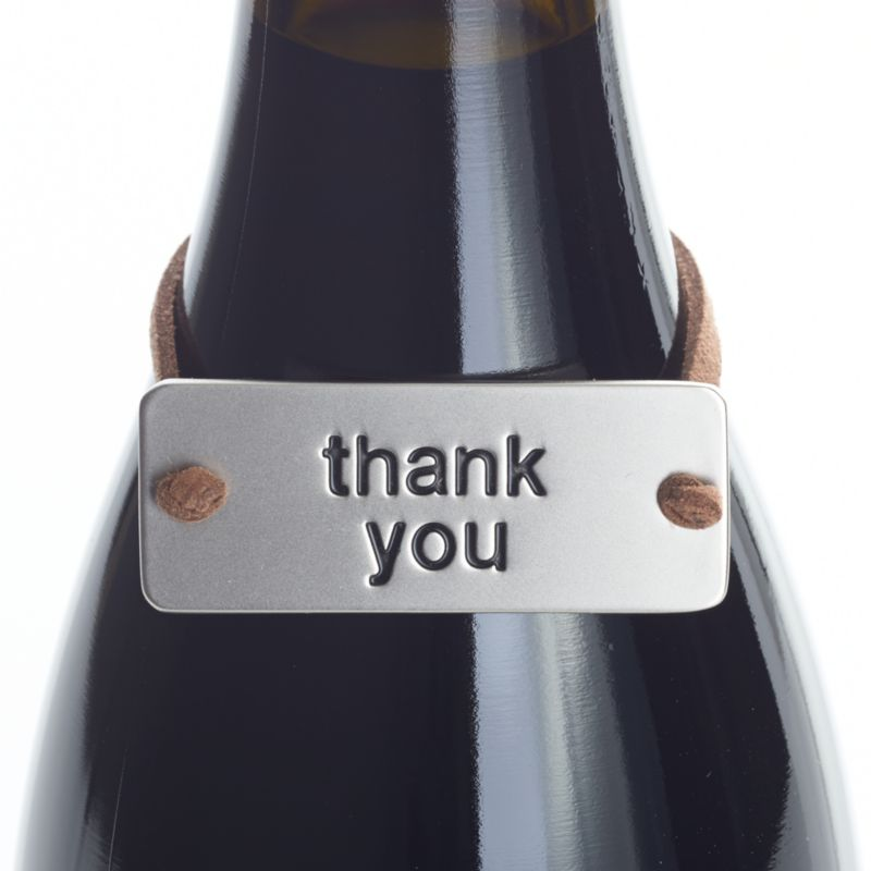 "Neat metal tag on a faux leather cord slips neatly over a gift bottle of wine, embossed to say a simple ""thank you.""<br /><br /><NEWTAG/><ul><li>Zinc with matte nickel plating</li><li>Faux leather cord</li><li>Clean with damp cloth</li><li>Made in China</li></ul>"