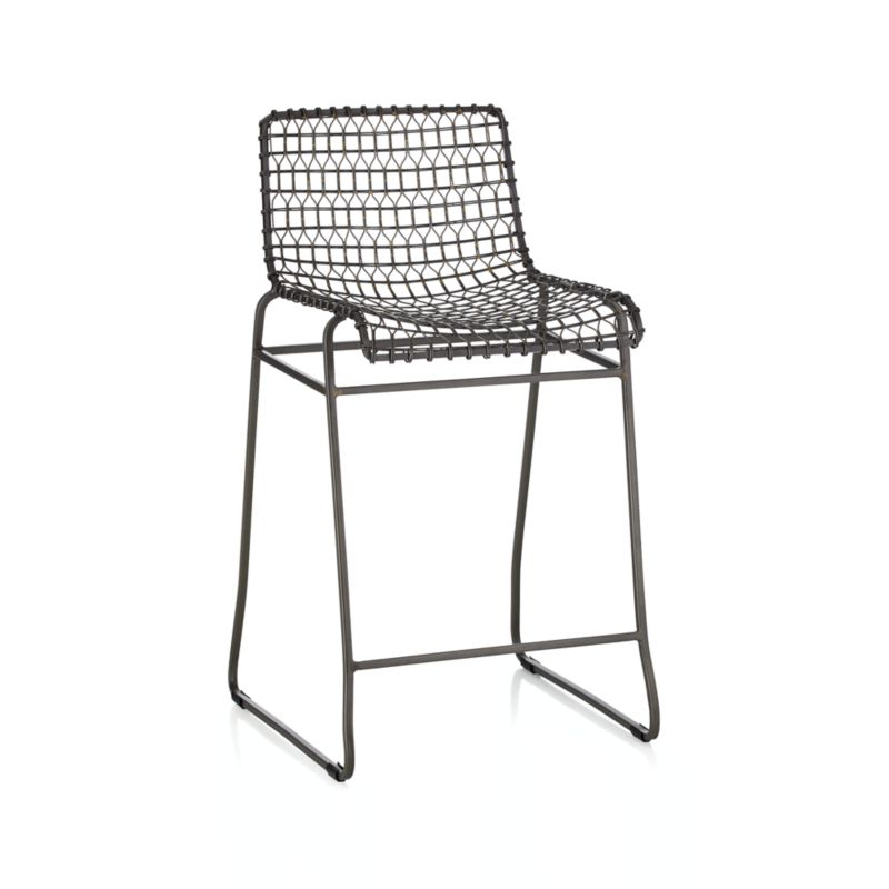 """Named for a complex welding technique used to secure non-ferrous metals and copper alloys, our Tig chair revels in the contrast of raw metals and the intricate welds that are typically covered with an opaque topcoat. Fashioning this kind of weld is difficult, and we relied on a team of highly skilled craftsmen who specialize a kind of wire weaving that's been passed along from generation to generation. Entirely handcrafted, each chair is crafted in three stages by teams expert in frame structures, wire patterns for the seat and back and the final welding. Once finished, chairs are given a light acid wash bath that results in a grey iron patina and brings out the shiny gold dots of the brass weld marks.<br /><br /><NEWTAG/><ul><li>Handcrafted</li><li>Iron rod and pip with brass welds</li><li>Acid wash bath finish and clear epoxy topcoat</li><li>Rubber feet</li><li>24"""" height for counters</li><li>Made in India</li></ul>"""