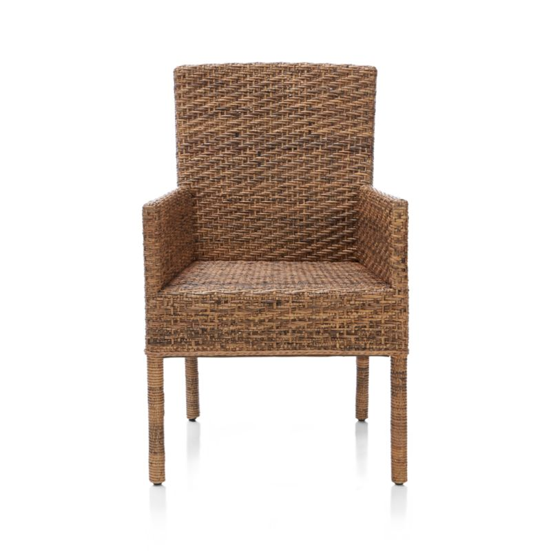 The particular species of rattan used in this contemporary arm chair has mottled honey tones that resemble a tiger's coat. Handwoven over a solid mahogany frame, the weave incorporates a vertical rattan core and rattan peel on the horizontal. Gently contoured back ensures a comfortable seat. Braided trim and wrapped legs add textural contrast.<br /><br /><NEWTAG/><ul><li>Mahogany wood frame</li><li>Natural tiger rattan with clear lacquer finish</li><li>Plastic glides</li><li>Indoor use only</li><li>Clean with a dry cloth</li><li>Made in Indonesia</li></ul>