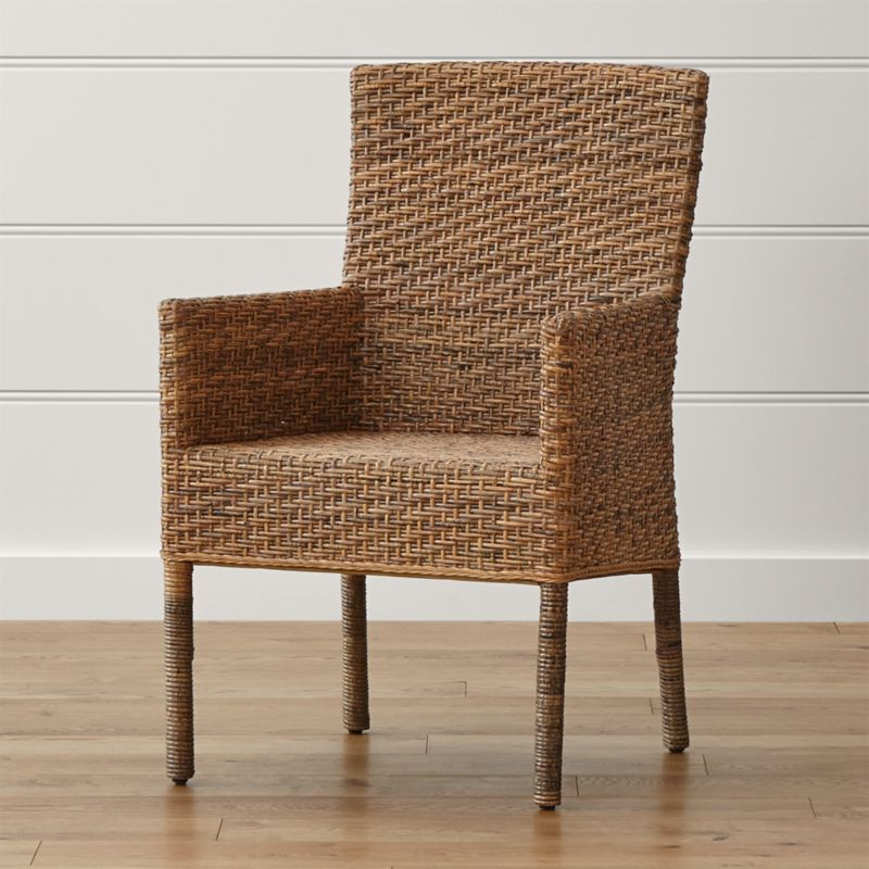 The particular species of rattan used in the Tigris Arm Chair has mottled honey tones that<br />resemble a tiger's coat. Handwoven over a solid mahogany frame, the weave incorporates<br />a vertical rattan core and horizontal rattan peel. <NEWTAG/><ul><li>Mahogany wood frame</li><li>Natural rattan peel surface</li><li>Tongue-and-groove joinery</li><li>Clear lacquer finish</li><li>Plastic glides</li><li>Made in Indonesia</li></ul><br />
