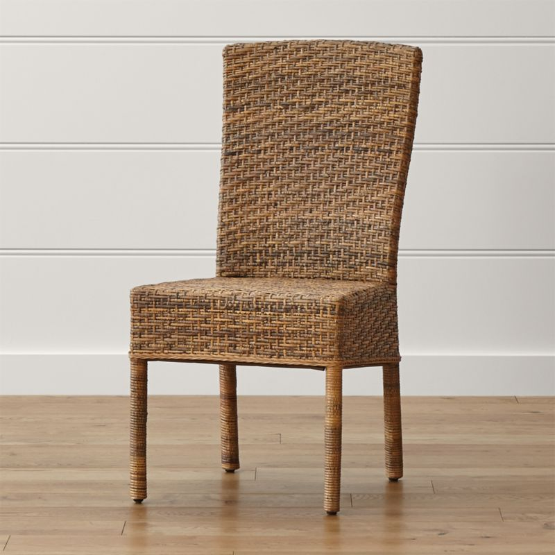 The particular species of rattan used in the Tigris Side Chair has mottled honey tones that<br />resemble a tiger's coat. Handwoven natural rattan peel is woven over a solid mahogany frame in a tropical rendition of the Parsons style chair. <NEWTAG/><ul><li>Mahogany wood frame</li><li>Natural rattan peel surface</li><li>Tongue-and-groove joinery</li><li>Clear protective lacquer finish</li><li>Floor protectors</li><li>Made in Indonesia</li></ul><br />
