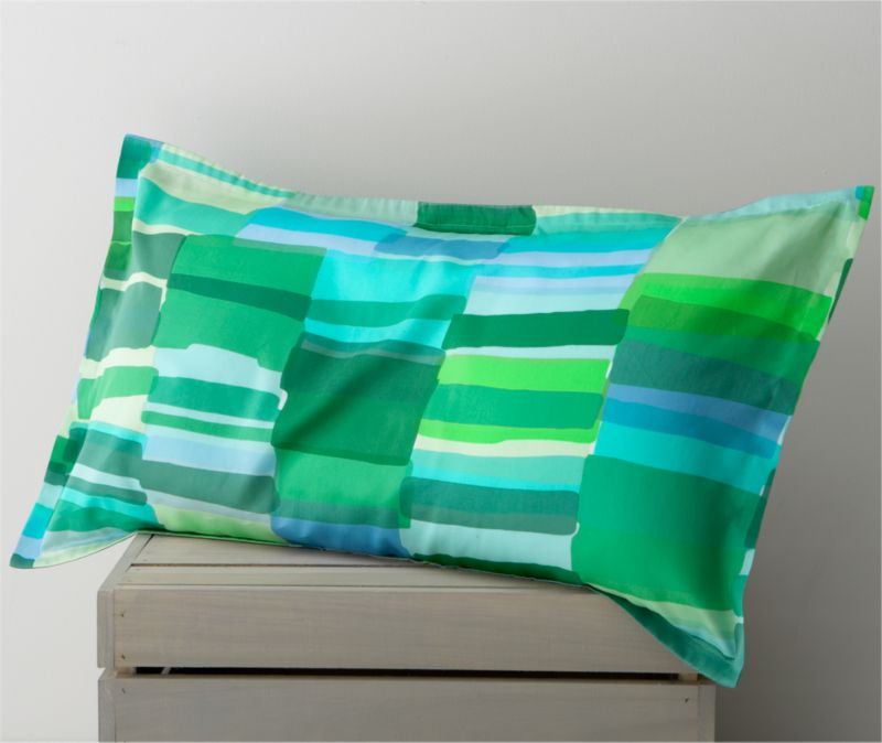 "Tilkkula (""scrap"") overlaps artfully irregular rectangles in a sea-inspired palette, designed by Erja Hirvi in 2006. Ultra-soft 300-thread-count cotton sateen sham has a 1"" flange and generous overlapping flap closure on the back. Bed pillows also available.<br /><br /><strong>Limited-time offer ends February 20, 2013.</strong><br /><br /><NEWTAG/><ul><li>Pattern designed by Erja Hirvi; 2006</li><li>100% cotton sateen</li><li>300-thread-count</li><li>Machine wash cold, tumble dry</li></ul>"