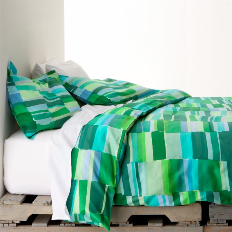"Tilkkula (""scrap"") overlaps artfully irregular rectangles in a sea-inspired palette, designed by Erja Hirvi in 2006.  Ultra-soft 300-thread-count cotton sateen covers are reversible and have hidden-button closures and interior ties to keep duvet insert snugly in place. Duvet inserts also available.<br /><br /><strong>Limited-time offer ends February 20, 2013.</strong><br /><br /><NEWTAG/><ul><li>Pattern designed by Erja Hirvi; 2006</li><li>100% cotton sateen</li><li>300-thread-count</li><li>Machine wash cold, tumble dry</li><li>Made in Pakistan</li></ul>"
