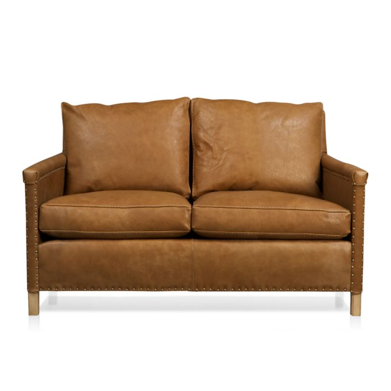 Instant heirloom is all about the nail head trim as well as the luxuriously soft, supple leather. Deeply cushioned sofa shows its old-school pedigree in the use of antique brass nails to upholster leather to the frame. Post legs and cable-stitched welting add to its timeless charm.<br /><br />After you place your order, we will send a leather swatch via next day air for your final approval. We will contact you to verify both your receipt and approval of the leather swatch before finalizing your order.<br /><br /><NEWTAG/><ul><li>Certified kiln-dried hardwood frame</li><li>8-way, hand-tied suspension</li><li>Cushions are soy-based polyfoam wrapped in 100% down encased in downproof ticking</li><li>Tight back is feather-down blend in downproof ticking</li><li>Top-grain, full-aniline leather with cable-stitched welting</li><li>Traditional upholstery technique with antique brass nailheads</li><li>Made in North Carolina, USA</li></ul>