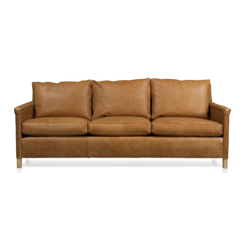 Instant heirloom is all about the nail head trim as well as the luxuriously soft, supple leather. Deeply cushioned sofa shows its old-school pedigree in the use of antique brass nails to upholster leather to the frame, especially visible in the folded leather detailing on the arms. Post legs and cable-stitched welting add to its timeless charm.<br /><br />After you place your order, we will send a leather swatch via next day air for your final approval. We will contact you to verify both your receipt and approval of the leather swatch before finalizing your order.<br /><br /><NEWTAG/><ul><li>Certified kiln-dried hardwood frame</li><li>8-way, hand-tied suspension</li><li>Cushions are soy-based polyfoam wrapped in 100% down encased in downproof ticking</li><li>Tight back is feather-down b