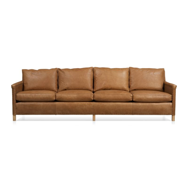 Instant heirloom is all about the nail head trim as well as the luxuriously soft, supple leather. Deeply cushioned sofa shows its old-school pedigree in the use of antique brass nails to upholster leather to the frame, especially visible in the folded leather detailing on the arms. Post legs and cable-stitched welting add to its timeless charm.<br /><br />After you place your order, we will send a leather swatch via next day air for your final approval. We will contact you to verify both your receipt and approval of the leather swatch before finalizing your order.<br /><br /><NEWTAG/><ul><li>Certified kiln-dried hardwood frame</li><li>8-way, hand-tied suspension</li><li>Cushions are soy-based polyfoam wrapped in 100% down encased in downproof ticking</li><li>Tight back is feather-down blend in downproof ticking</li><li>Top-grain, full-aniline leather with cable-stitched welting</li><li>Traditional upholstery technique with antique brass nailheads</li><li>Made in North Carolina, USA</li></ul>