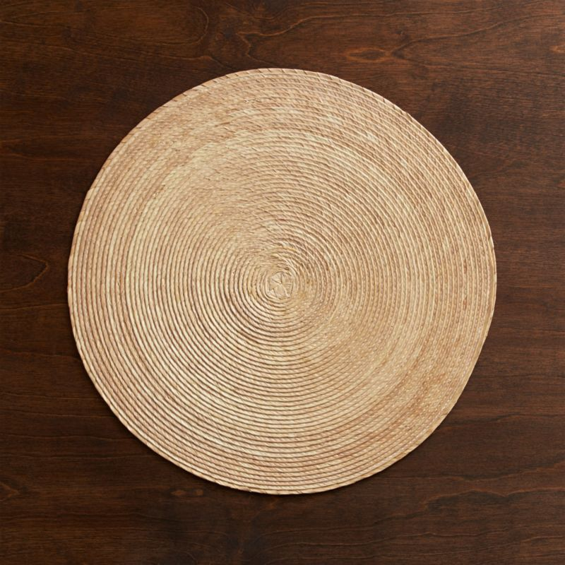 Colorful round is handmade from natural Mexican palm and sealed with a wax finish for easy cleanup.<br /><br /><NEWTAG/><ul><li>100% palm fiber placemat</li><li>Clean placemat with a damp cloth</li><li>Made in Mexico</li></ul><br />
