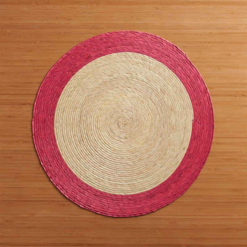Colorful round with contrasting rim is handmade from natural palm fibers and sealed with a wax finish for easy cleanup.<br /><br /><NEWTAG/><ul><li>98% palm fiber and 2% string</li><li>Wipe clean with damp cloth</li><li>Made in Mexico</li></ul>