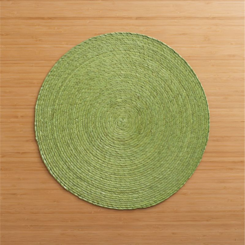 Colorful round is handmade from natural Mexican palm and sealed with a wax finish for easy cleanup.<br /><br /><NEWTAG/><ul><li>100% palm fiber</li><li>Clean with a damp cloth</li><li>Made in Mexico</li></ul>