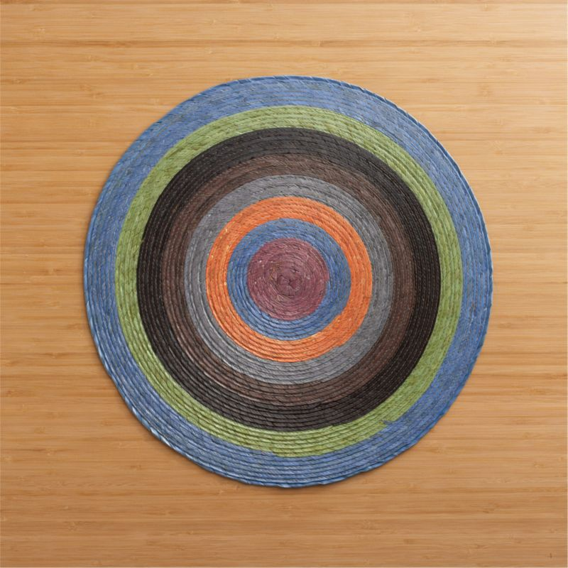 Colorful round radiates richly hued circles, handmade from natural Mexican palm and sealed with a wax finish for easy cleanup.<br /><br /><NEWTAG/><ul><li>100% palm fiber</li><li>Clean with a damp cloth</li><li>Made in Mexico</li></ul>