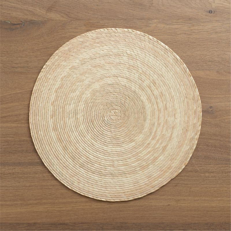Colorful round is handmade from natural Mexican palm and sealed with a wax finish for easy cleanup.<br /><br /><NEWTAG/><ul><li>100% palm fiber</li><li>Wipe clean with damp cloth</li><li>Made in Mexico</li></ul>