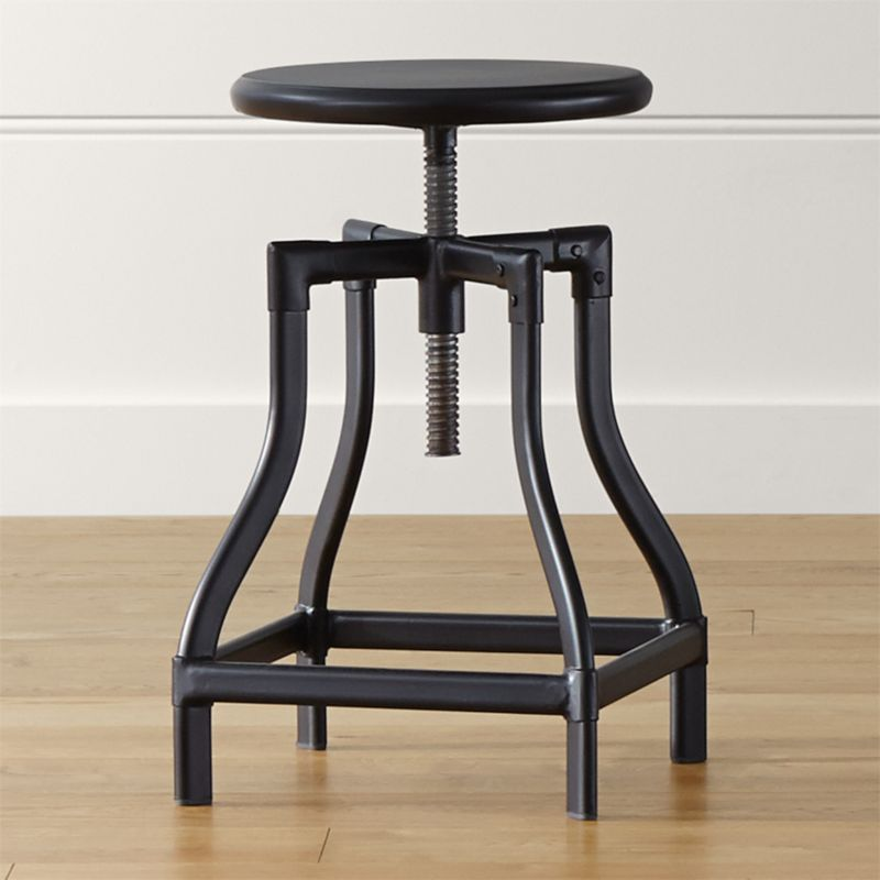 Turner puts a fresh twist on industrial seating with a vintage, architectural look in a clean silhouette. Crafted in sheet and tubular metal enhanced with a black steel finish with faux rivet detailing, the adjustable seat easily rotates from counter to bar stool height. The Turner Black Counter-Bar Stool is a Crate and Barrel exclusive.<br /><br /><NEWTAG/><ul><li>Metal sheet and oval tube in black steel finish</li><li>Seat is not removable</li><li>Black plastic floor glides</li><li>Made in The Philippines</li></ul><br />