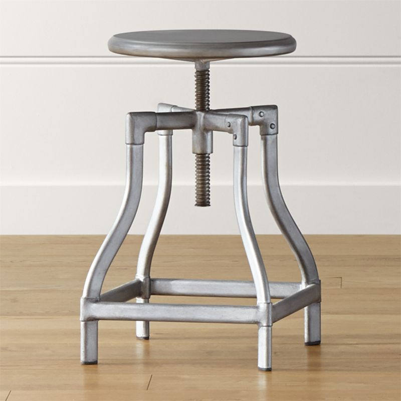 Turner puts a fresh twist on industrial seating with a vintage, architectural look in a clean silhouette. Crafted in sheet and tubular metal enhanced with a gunmetal steel finish with faux rivet detailing, the rotating seat is easily adjustable from counter to bar height. The Turner Gunmetal Counter-Bar Stool is a Crate and Barrel exclusive.<br /><br /><NEWTAG/><ul><li>Metal sheet and oval tube in gunmetal finish</li><li>Seat is not removable</li><li>Black plastic floor glides</li><li>Made in The Philippines</li></ul><br /><br />