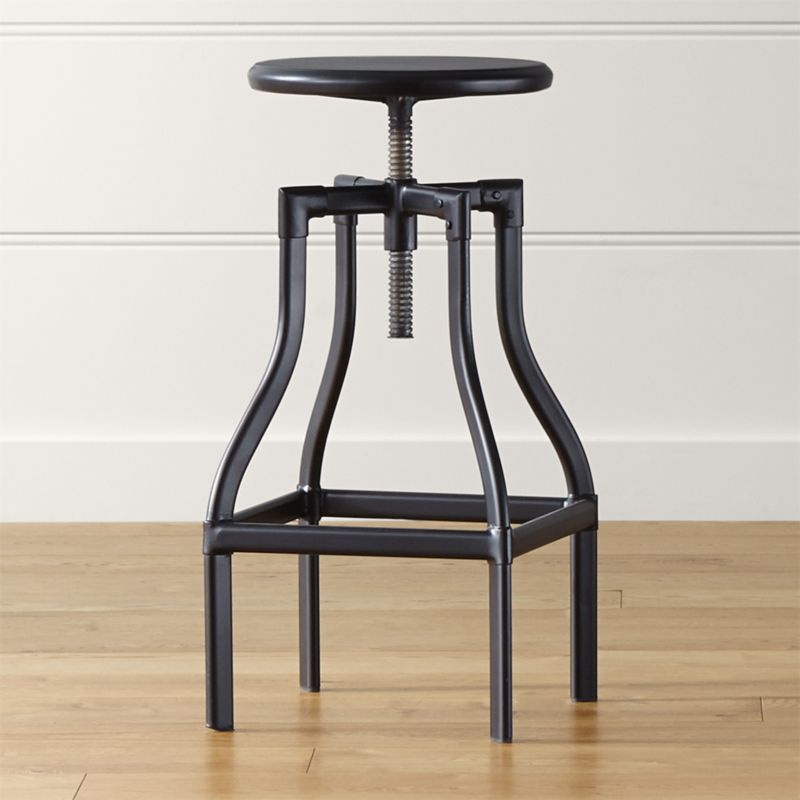 Turner puts a fresh twist on industrial seating with a vintage, architectural look in a clean silhouette. Crafted in sheet and tubular metal enhanced with a black steel finish with faux rivet detailing, the swivel seat is easily adjustable from dining to counter height. The Turner Black Dining-Counter Stool is a Crate and Barrel exclusive.<br /><br /><NEWTAG/><ul><li>Metal sheet and oval tube in black steel finish</li><li>Seat is not removable</li><li>Black plastic floor glides</li><li>Made in The Philippines</li></ul><br />