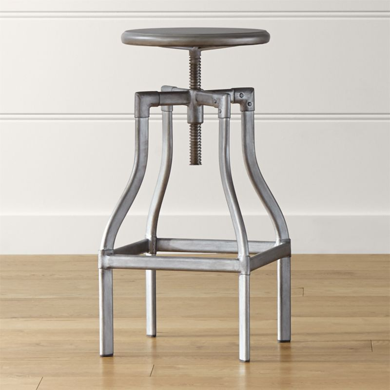 Turner puts a fresh twist on industrial seating with a vintage, architectural look in a clean silhouette. Crafted in sheet and tubular metal enhanced with a gunmetal steel finish with faux rivet detailing, the rotating seat easily adjusts from counter to bar height. The Turner Gunmetal Counter-Bar Stool is a Crate and Barrel exclusive.<br /><br /><NEWTAG/><ul><li>Metal sheet and oval tube in gunmetal finish</li><li>Seat is not removable</li><li>Black plastic floor glides</li><li>Made in The Philippines</li></ul><br />
