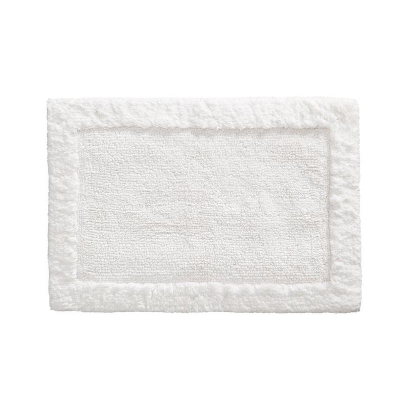Treat your feet to the plush comfort of 100% cotton, looped and sheared to create a super soft and absorbent. Reversible bordered pattern.<br /><br /><NEWTAG/><ul><li>100% cotton</li><li>1,208 gram weight</li><li>Machine wash</li><li>Made in India</li></ul>