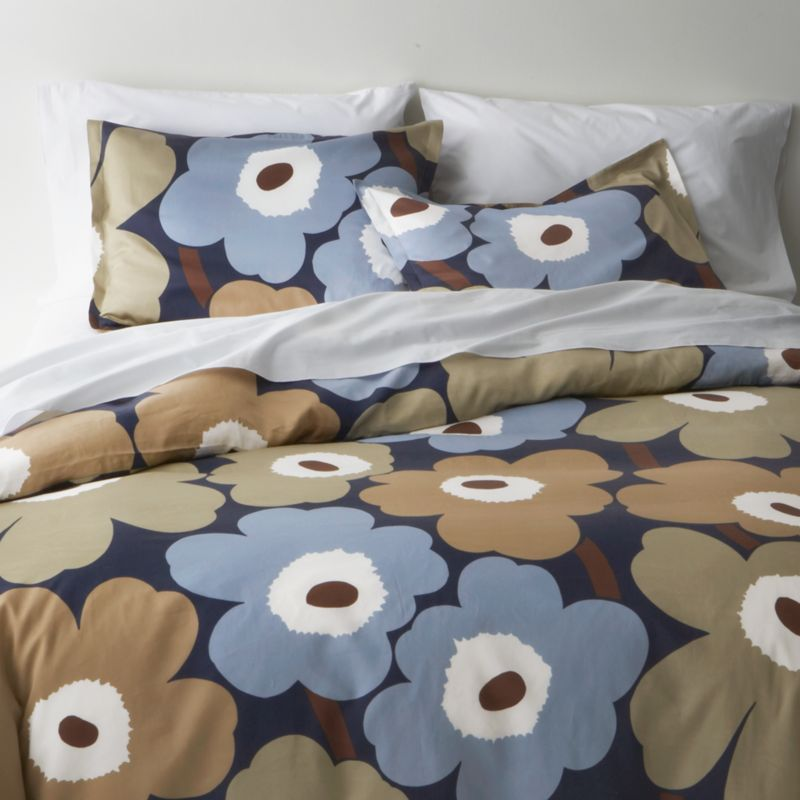 "Designed in 1964 by Maija Isola, the Unikko (""poppy"") design has been the most popular Marimekko print since its introduction. Challenging the common notion of decorative florals, Unikko broke from tradition with its creative pop art interpretation in bold, simplified pattern and bright color. Reproduced in infinite color combinations over its 47-year history, the pattern remains current while symbolizing the free spirit of its designer and those who admire it. Duvet cover reverses to self, with hidden button closure at bottom and interior fabric ties to hold the insert in place. Duvet inserts also available.<br /><br /><NEWTAG/><ul><li>Pattern designed by Maija Isola; 1964</li><li>100% cotton sateen</li><li>300-thread-count</li><li>Machine wash cold</li></ul>"