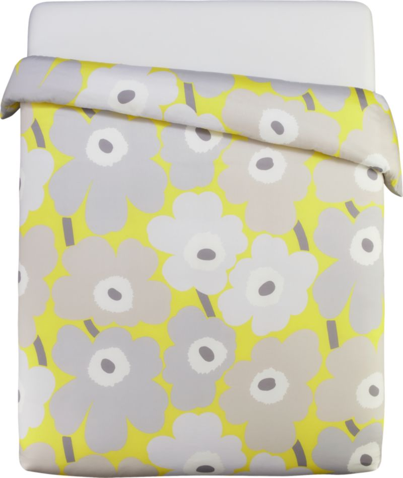 "Designed in 1964 by Maija Isola, the Unikko (""poppy"") design has been the most popular Marimekko print since its introduction. Challenging the common notion of decorative florals, Unikko broke from tradition with its creative pop art interpretation in bold, simplified pattern and bright color. Reproduced in infinite color combinations over its 47-year history, the pattern remains current while symbolizing the free spirit of its designer and those who admire it. Reversible duvet cover has a hidden button closure at the bottom and interior fabric ties to hold the insert in place. Duvet inserts also available.<br /><br /><NEWTAG/><ul><li>Pattern designed by Maija Isola; 1964</li><li>100% cotton sateen</li><li>300-thread-count</li><li>Machine wash cold</li><li>Made in Pakistan</li></ul>"