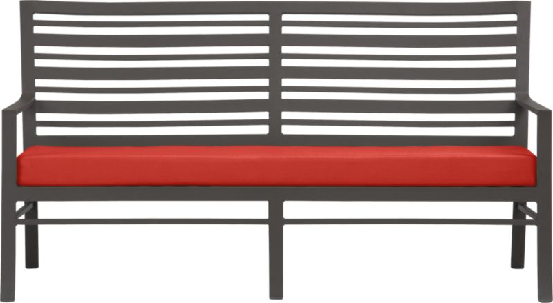 Welcome entertaining with a park bench-style sofa. Varied-size back slat design is crafted of durable, lightweight extruded aluminum. Smooth, rustproof bronze powdercoat finish stands up to the elements. Sofa cushion is covered in fade- and mildew-resistant Sunbrella acrylic in caliente. Fabric tab fasteners hold cushion in place. Valencia dining collection also available.<br /><ul><li>Rustproof extruded aluminum</li><li>Bronze powdercoat finish</li><li>Cushion cover is fade- and mildew-resistant Sunbrella acrylic</li><li>Polyfoam insert</li><li>Spot clean cushion cover</li><li>Made in Vietnam and USA </li></ul><NEWTAG/>