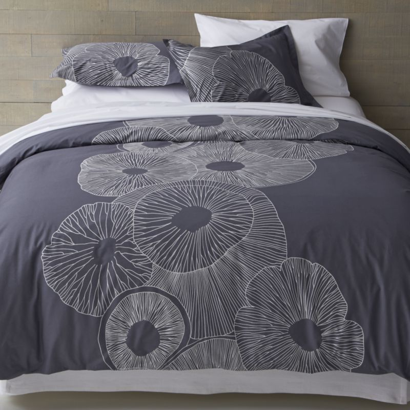 """Erja Hirvi's 2008 design takes a look at the underside of mushroom (""""Valmuska"""") caps in a graceful pattern of overlapping, organically shaped circles filled with delicate tracings of mushroom gills. Reversible duvet cover has hidden button closure at bottom and interior fabric ties to hold the insert in place. Duvet inserts also available.<br /><br /><NEWTAG/><ul><li>Pattern designed by Erja Hirvi; 2008</li><li>100% cotton</li><li>300-thread-count</li><li>Machine wash cold, tumble dry low; warm iron as needed</li><li>Made in Pakistan</li></ul>"""