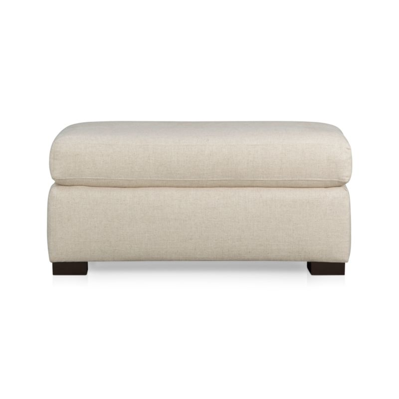 Extremely livable neutral linen that's luxuriously spare to dress up or down covers this graceful extra seating. Plump cushion sinks in with an extra layer of down feathers. Chunky hardwood legs are stained dark brown.<br /><br />After you place your order, we will send a fabric swatch via next day air for your final approval. We will contact you to verify both your receipt and approval of the fabric swatch before finalizing your order.<br /><br /><NEWTAG/><ul><li>Eco-friendly construction</li><li>Certified sustainable, kiln-dried hardwood frame</li><li>Cushion is soy-based polyfoam</li><li>Upholstery fabric is rayon-poly-linen blend with topstitched seam detail</li><li>Sinuous wire suspension</li><li>Benchmade</li><li>See additional frame options below</li><li>Made in North Carolina, USA</li></ul>