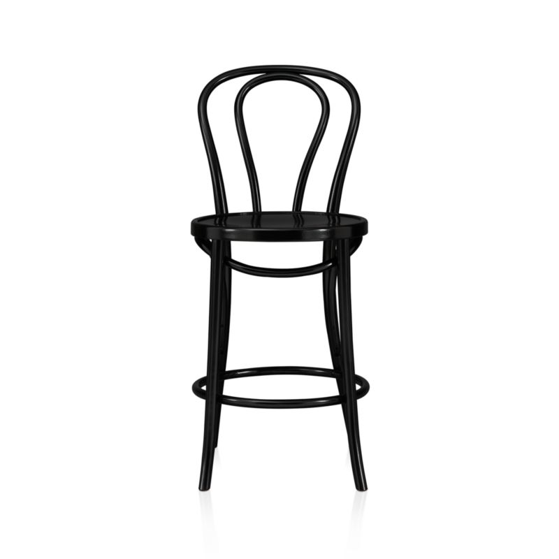 In 1859, Michael Thonet introduced the concept of bending wood with steam to design the iconic bentwood chair. Today, our bent beechwood Vienna counter stool is produced in one of the original Thonet factories in Europe. <NEWTAG/><ul><li>Bent beechwood frame and seat in black lacquer finish</li><li>Engineered wood seat</li><li>Made in Poland</li></ul><br />