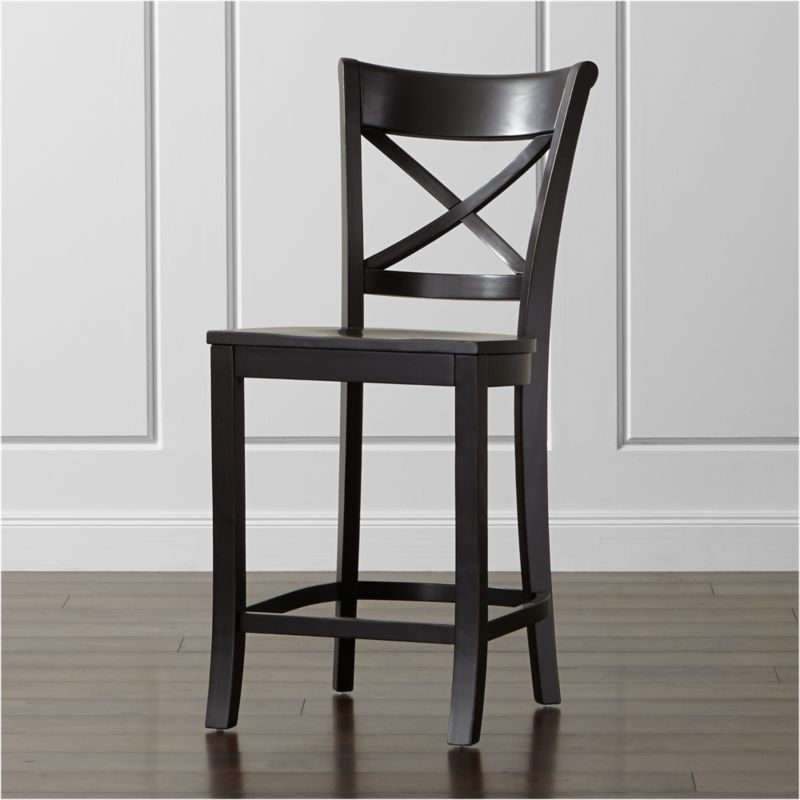 """Vintner's contoured """"X"""" back and comfortable, carved seat support you in all the right places. This substantial farmhouse-style counter stool is crafted of solid wood with a black-painted finish that's hand-rubbed at the edges. <NEWTAG/><ul><li>Sustainable solid rubberwood</li><li>Hand-rubbed black painted finish with clear lacquer topcoat</li><li>Made in Vietnam</li></ul><br />"""