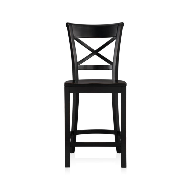 "Vintner's contoured ""X"" back and comfortable, carved seat support you in all the right places. This substantial farmhouse-style counter stool is crafted of solid wood with a black-painted finish that's hand-rubbed at the edges. <NEWTAG/><ul><li>Sustainable solid rubberwood</li><li>Hand-rubbed black painted finish with clear lacquer topcoat</li><li>Made in Vietnam</li></ul><br />"