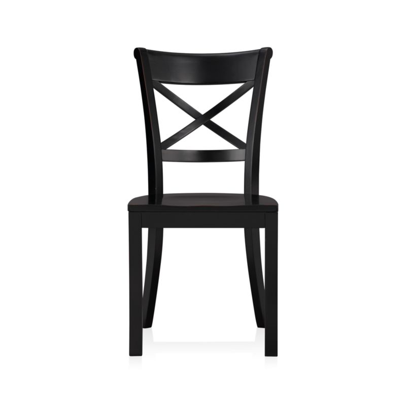 """With its contoured """"X"""" back and comfortable, carved seat, our Vintner side chair supports you in all the right places. With a substantial farmhouse aesthetic, this classic side chair is crafted of solid wood with a painted black finish that's hand-rubbed at the edges for a lived-in look. <NEWTAG/><ul><li>Sustainable solid rubberwood</li><li>Hand-rubbed black painted finish with clear lacquer topcoat</li><li>Made in Vietnam</li></ul><br /><br />"""