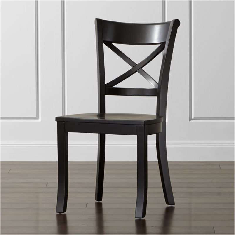 "With its contoured ""X"" back and comfortable, carved seat, our Vintner side chair supports you in all the right places. With a substantial farmhouse aesthetic, this classic side chair is crafted of solid wood with a painted black finish that's hand-rubbed at the edges for a lived-in look. <NEWTAG/><ul><li>Sustainable solid rubberwood</li><li>Hand-rubbed black painted finish with clear lacquer topcoat</li><li>Made in Vietnam</li></ul><br /><br />"