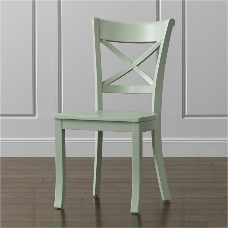 "Inspired by the substantial kitchen and dining chairs of farmhouses past, our classic Vintner side chair supports you in all the right places with its ""X"" back and comfortable, carved seat. With sustainable solid wood construction and a retro mint green painted finish, this charming, comfortable chair lends the look of an inherited family piece or flea market find to any setting. The Vintner Mint Side Chair is a Crate and Barrel exclusive.<br /><br /><NEWTAG/><ul><li>Sustainable solid rubberwood</li><li>Mint green painted finish with clear lacquer topcoat</li><li>Made in Vietnam</li></ul><br /><br />"