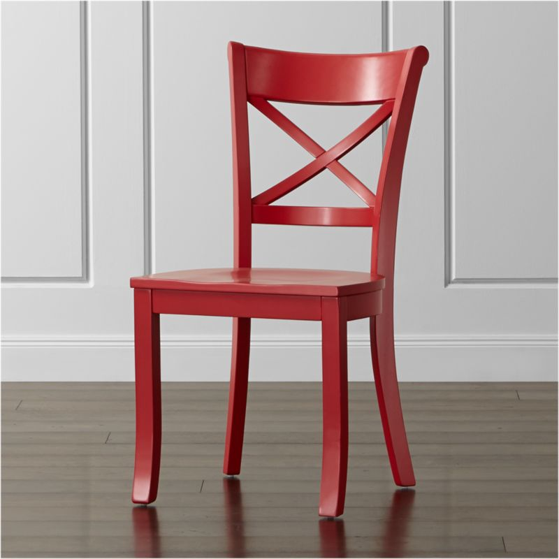 """This vibrant version of our classic Vintner farmhouse-style chair takes the solid, sustainable wood construction with contoured """"X"""" back and comfortable, carved seat and paints it in eye-catching red. Familiar, retro styling makes the Vintner side chair an instant member of the family. The Vintner Red Side Chair is a Crate and Barrel exclusive.<br /><br /><NEWTAG/><ul><li>Sustainable solid rubberwood</li><li>Red painted finish with clear lacquer topcoat</li><li>Made in Vietnam</li></ul><br /><br />"""