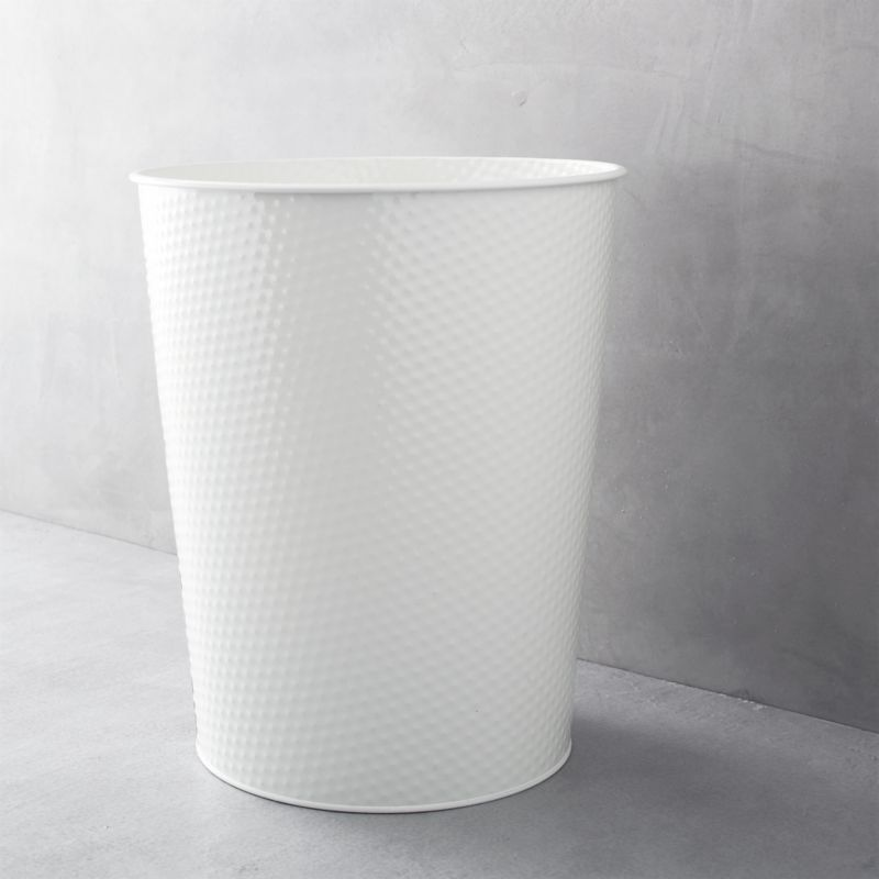 Utilitarian chic for any room in the home or workplace. Tapered waste can with distinctive dimpled design and three-gallon capacity is durably crafted of steel with a neutral cream powdercoat finish.<br /><br /><NEWTAG/><ul><li>100% steel</li><li>Cream powdercoat finish</li><li>3-gallon capacity</li><li>Clean with a dry cloth</li><li>Made in China</li></ul>