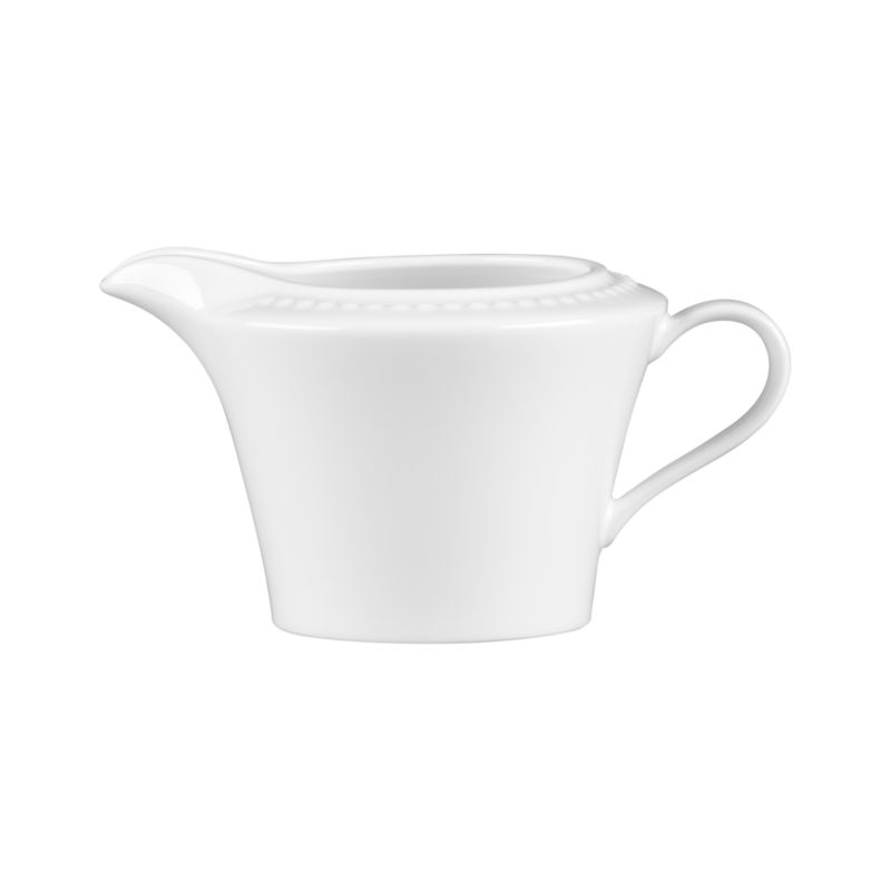 Inspired by the simple elegance of a pearl. Beautiful embossed dots on white bone china create a durable creamer with timeless appeal. White Pearl dinnerware also available.<br /><br /><NEWTAG/><ul><li>Superior quality and design</li><li>Dishwasher- and microwave-safe</li><li>Made in Japan</li></ul>by Nikko Ceramics<br />