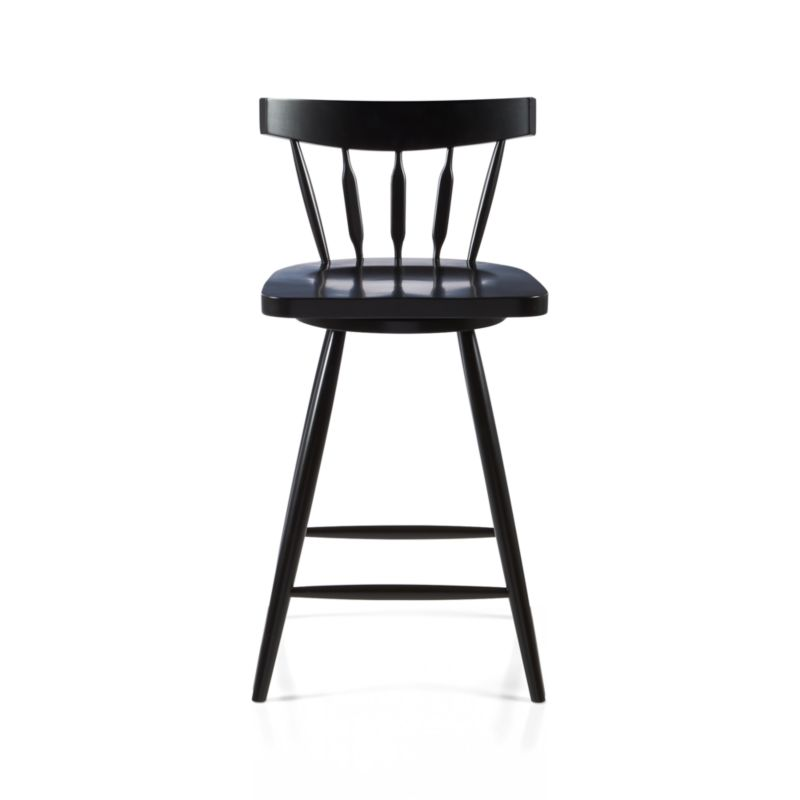"""The ever-popular Windsor chair sits up and gets noticed as a swivel stool designed by Mark Daniel. Black beechwood frame brings the design up to date with slender spindle back, angled legs and subtle saddle seat. Seat features a 360-degree swivel and a foot rest for added comfort. 24 """" height accommodates counters.<br /><br /><NEWTAG/><ul><li>Beechwood with black finish and clear lacquer topcoat</li><li>Tenon joinery</li><li>360-degree swivel mechanism</li><li>Feet have plastic glides</li><li>24"""" height for counters</li><li>Dust with soft dry cloth</li><li>Made in China</li></ul>"""