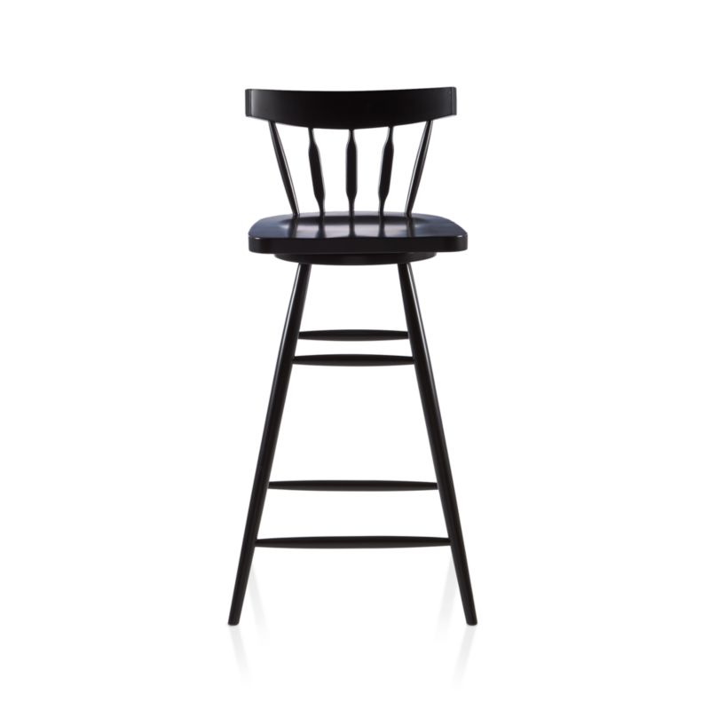 """The ever-popular Windsor chair sits up and gets noticed as a swivel stool designed by Mark Daniel. Black beechwood frame brings the design up to date with slender spindle back, angled legs and subtle saddle seat. Seat features a 360-degree swivel and a foot rest for added comfort. 30 """" height accommodates bars and high dining tables.<br /><br /><NEWTAG/><ul><li>Beechwood with black finish and clear lacquer topcoat</li><li>Tenon joinery</li><li>360-degree swivel mechanism</li><li>Feet have plastic glides</li><li>30"""" height for counters and high dining tables</li><li>Dust with soft dry cloth</li><li>Made in China</li></ul>"""