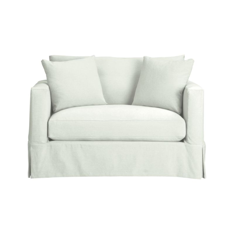 "A modern sensibility for the casual cottage look. Machine-washable slipcover for Willow Chair and a Half with crisp tailoring and topstitch detailing is made of pre-washed cotton-blend for a softer, lived-in touch.<br /><br />Additional <a href=""http://crateandbarrel.custhelp.com/cgi-bin/crateandbarrel.cfg/php/enduser/crate_answer.php?popup=-1&p_faqid=125&p_sid=DMUxFvPi"">slipcovers</a> available below and through stores featuring our Furniture Collection.<br /><br />After you place your order, we will send a fabric swatch via next day air for your final approval. We will contact you to verify both your receipt and approval of the fabric swatch before finalizing your order.<br /><br /><NEWTAG/><ul><li>Pre-washed cott"