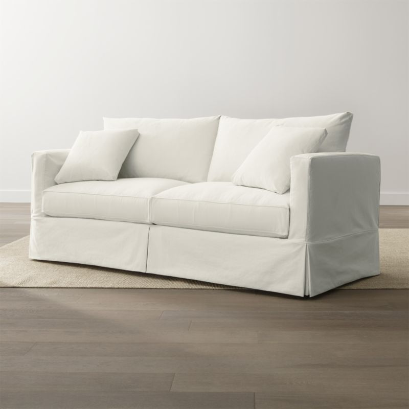 """Willow's more modern lines relax in cottage style, instantly putting family rooms, casual living rooms and guest bedrooms in a vacation state of mind. Deep cushions and a machine-washable slipcover are tailored in a cotton-blend fabric pre-washed for a softer, lived-in touch. <NEWTAG/><ul><li>Frame is benchmade in the USA with a certified sustainable hardwood that's kiln-dried to prevent warping</li><li>Soy-based polyfoam seat cushions wrapped in fiber-down blend and recycled fiber, encased in downproof ticking</li><li>Fiber-down blend back cushions and throw pillows encased in downproof ticking</li><li>Includes two knife-edge throw pillows</li><li>5½"""" bi-fold innerspring mattress</li><li>100 percent cotton muslin base</li><li>Removable, pre-washed slipcover is machine washable</li><li>Topstitching and self-welt detail</li><li>Material origin: see swatch</li><li>Made in North Carolina, USA</li></ul>"""