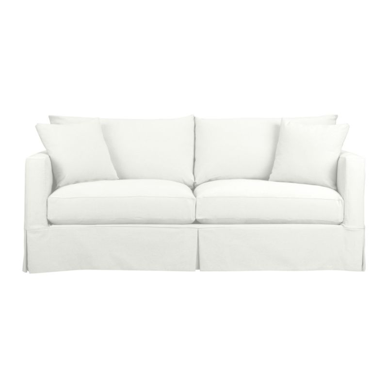 "A modern sensibility for the casual cottage look. Machine-washable slipcover for Willow Sofa with crisp tailoring and topstitch detailing is made of pre-washed cotton-blend for a softer, lived-in touch.<br /><br />Additional <a href=""http://crateandbarrel.custhelp.com/cgi-bin/crateandbarrel.cfg/php/enduser/crate_answer.php?popup=-1&p_faqid=125&p_sid=DMUxFvPi"">slipcovers</a> available below and through stores featuring our Furniture Collection.<br /><br />After you place your order, we will send a fabric swatch via next day air for your final approval. We will contact you to verify both your receipt and approval of the fabric swatch before finalizing your order.<br /><br /><NEWTAG/><ul><li>Pre-washed cotton-poly blend with topstitch and self-welt detail</li><li>Machine wash</li><li>Made in North Carolina, USA</li></ul>"