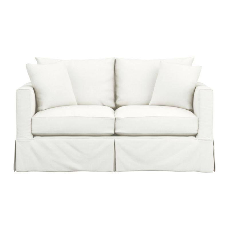 "Introducing a modern new sensibility for the casual cottage look. Contemporary design relaxes with the deep, sink-in hospitality of the plump-cushioned, slipcovered apartment sofa—but with minimalist track arms at a sheltering height (great for curling up in the corner), and crisp tailoring. Machine-washable slipcover with topstitch detailing is made of pre-washed cotton-blend for a softer, lived-in touch.<br /><br />Additional <a href=""http://crateandbarrel.custhelp.com/cgi-bin/crateandbarrel.cfg/php/enduser/crate_answer.php?popup=-1&p_faqid=125&p_sid=DMUxFvPi"">slipcovers</a> available below and through stores featuring our Furniture Collection.<br /><br />After you place your order, we will send a fabric swatch via next day air for your final approval. We will contact you to verify both your receipt and approval of the fabric swatch before finalizing your order.<br /><br /><NEWTAG/><ul><li>Eco-friendly construction</li><li>Certified sustainable, kiln-dried hardwood frame</li><li>Multilayer seat cushions are soy- or plant"