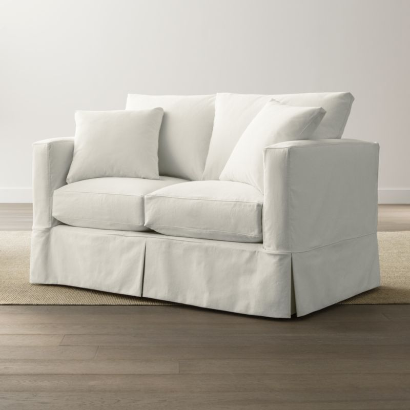 With modern lines that relax in cottage style, our slipcovered Willow collection instantly puts family rooms and casual living rooms in a vacation state of mind. Convenient replacement loveseat slipcover fitted with inverted kick pleats, welting and topstitching to keep it neatly in place assures a fresh look when it's time to launder the originals. <NEWTAG/><ul><li>Removable, pre-washed slipcover is machine washable</li><li>Topstitching and self-welt detail</li><li>Material origin: see swatch</li><li>Made in North Carolina, USA</li></ul>