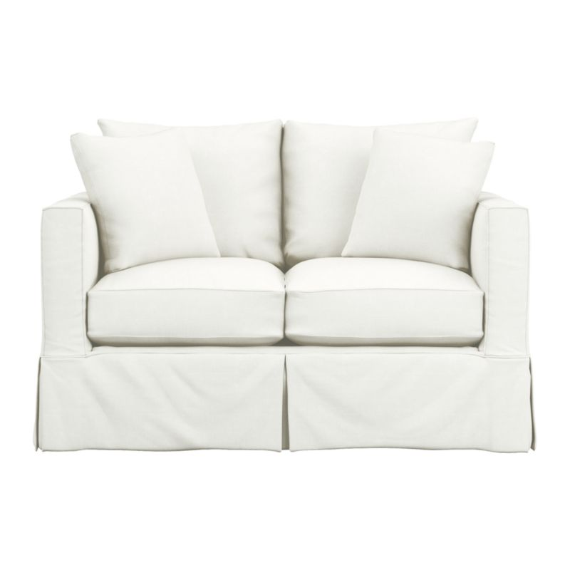 "Introducing a modern new sensibility for the casual cottage look. Contemporary design relaxes with the deep, sink-in hospitality of the plump-cushioned, slipcovered loveseat—but with minimalist track arms at a sheltering height (great for curling up in the corner), and crisp tailoring. Machine-washable slipcover with topstitch detailing is made of pre-washed cotton-blend for a softer, lived-in touch.<br /><br />Additional <a href=""http://crateandbarrel.custhelp.com/cgi-bin/crateandbarrel.cfg/php/enduser/crate_answer.php?popup=-1&p_faqid=125&p_sid=DMUxFvPi"">slipcovers</a> available below and through stores featuring our Furniture Collection.<br /><br />After you place your order, we will send a fabric swatch via next day air for your final approval. We will contact you to verify both your receipt and approval of the fabric swatch before finalizing your order.<br /><br /><NEWTAG/><ul><li>Eco-friendly construction</li><li>Certified sustainable, kiln-dried hardwood frame</li><li>Multi-layer seat cushion is soy- or plant-based polyfoam wrapped in fiber down blend and encased in downproof ticking</li><li>Seat back is fiber down blend encased in downproof ticking</li><li>Flexolator spring suspension</li><li>Slipcover fabric is pre-washed cotton-poly blend with topstitch and self-welt detail</li><li>Machine wash the removable slipcovers</li><li>Includes two knife-edge throw pillows with feather blend fill</li><li>Benchmade</li><li>See additional frame options below</li><li>Made in North Carolina, USA</li></ul>"