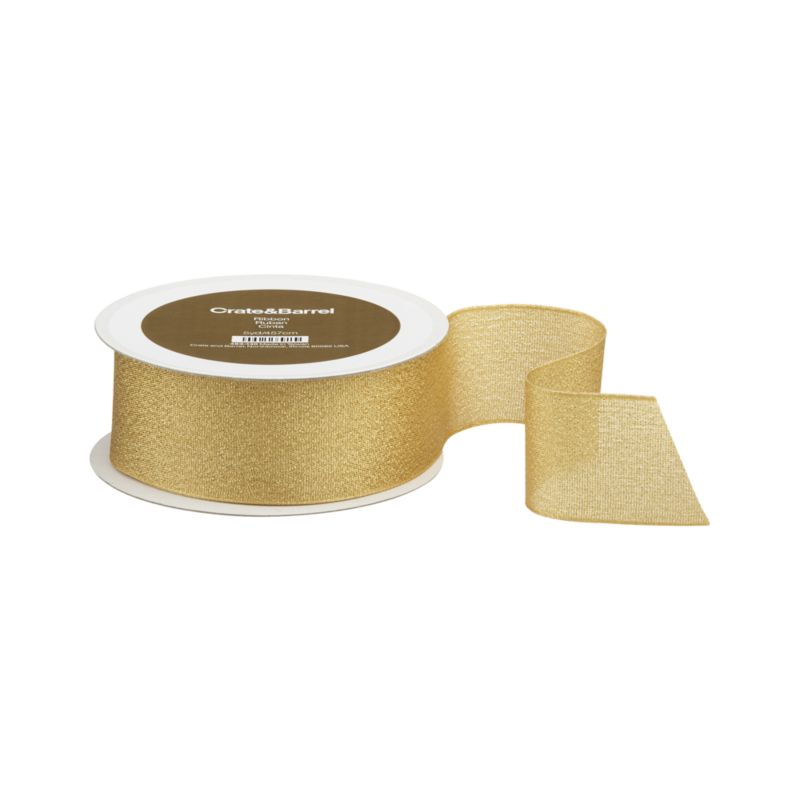 Gold taffeta ribbon sparkles festive shimmer. Wired edges craft shapely bows that hold their own.<br /><br /><NEWTAG/><ul><li>Polyester taffeta</li><li>Wired edges</li><li>Made in Taiwan</li></ul><br />