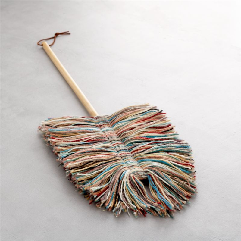 Dust doesn't stand a chance with this pure wool duster handcrafted in Vermont. The natural properties of lanolin draw and hold dust until you're ready to give the duster a good shake. Each removable mop head is a unique combination of multicolored wool fibers and is securely affixed to a sturdy poplar wood pole with fabric tab fasteners.  Flexible head reaches tight spots. Best of all, wool has twice the life expectancy of cotton mops.<br /><br /><NEWTAG/><ul><li>Pure wool mop head</li><li>Poplar wood handle</li><li>Head attaches to pole with fabric tab fasteners</li><li>Hand wash the removable wool head</li><li>Made in USA</li></ul>