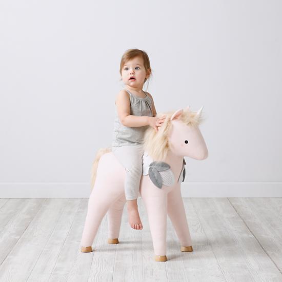 my pet unicorn plush ride on toy the land of nod. Black Bedroom Furniture Sets. Home Design Ideas